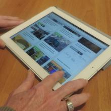Tablet computer with the magazine's home page.