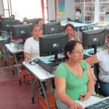 Women farmers at a computer class in the library.