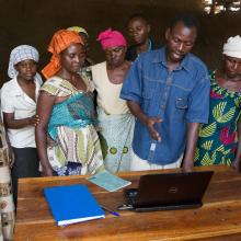 Farmers learn to use a note-book computer.