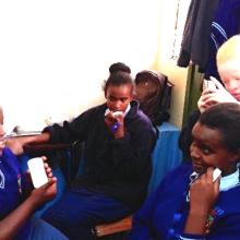 Visually impaired schoolchildren using DAISY (digital audio) devices in Nairobi Area Library.