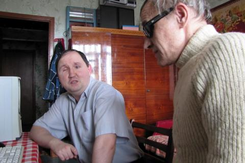 AT HOME: The library's blind trainer Mr Sergey Rakachov, right, works with trainee Mr Dmitriy Shapovalov at his home.
