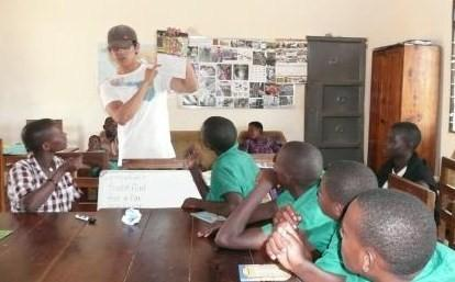 Deaf and hearing children learn together in Kitengesa Community Library.