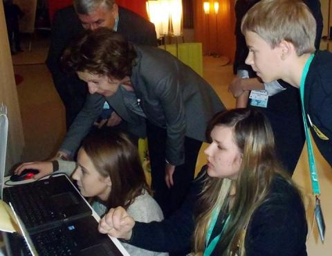 LEARNING TO PLAY: Neelie Kroes, Vice President of the European Union Commission responsible for the Digital Agenda, learns about Utena A.&M. Miskiniai Public Library's innovative educational computer game at ICT 2013 - Europe's biggest technology conference - in Vilnius, Lithuania.