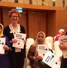 Teresa Hackett, EIFL Copyright and Libraries Programme Manager and Victoria Owen, University of Toronto Scarborough, share copies of the new Marrakesh Treaty guide launched at IFLA WLIC 2018 in Kuala Lumpur.