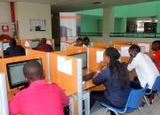 Students learning on computers in a library.