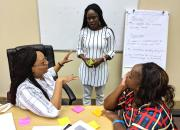 Three public librarians discuss project management during training in Windhoek in February 2019.