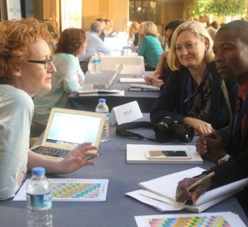 EIFL Copyright and Libraries Programme Manager Teresa Hackett discusses copyright with librarians from Angola and Lithuania at the EIFL General Assembly.