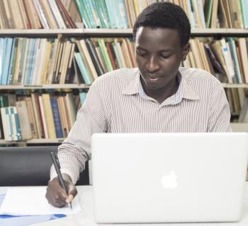 Student using a computer to conduct research, using EIFL-licensed e-resources.