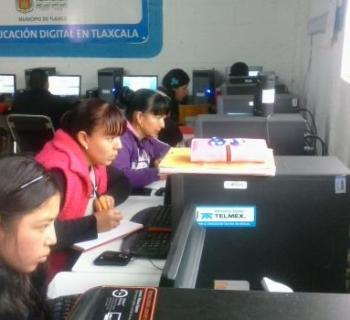 People using computers in Public Library 'Victoria Dorantes' No. 382, which serves the Atotonilco community in Tlaxo municipality in south-central Mexico.