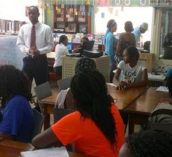 A businessman shares experiences of the world of work with young job-seekers in Micoud Public Library, St Lucia, Caribbean.
