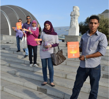 Photo of four researchers and students in Egypt advocating for open access.