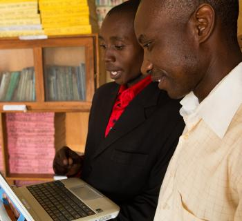 Librarians scan the computers at the Bwera Information Centre and Community Library in Kasese District in Western Uganda.