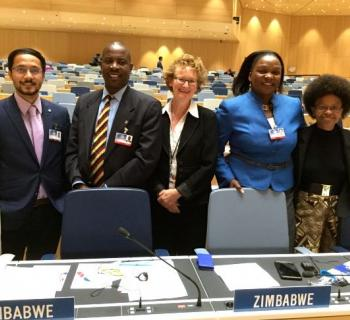 Zimbabwe and Nepal delegates with Teresa Hackett in WIPO hall