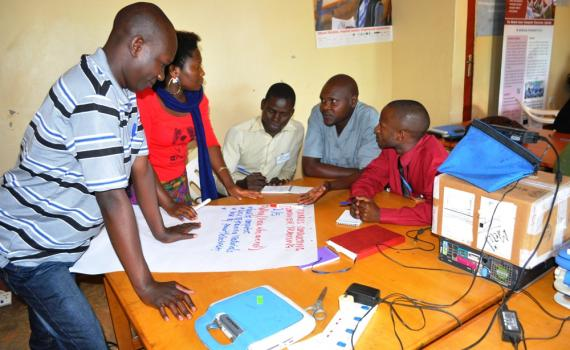 ibrarians writing on big sheets of paper during training