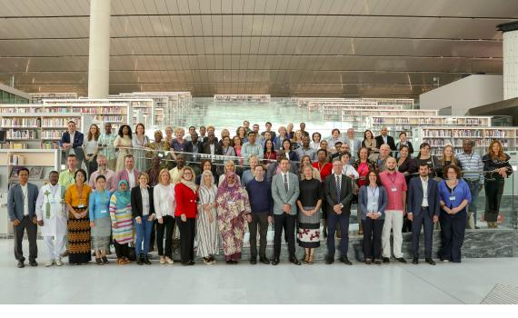All the delegates to the 2018 EIFL General Assembly standing in Qatar National Library.