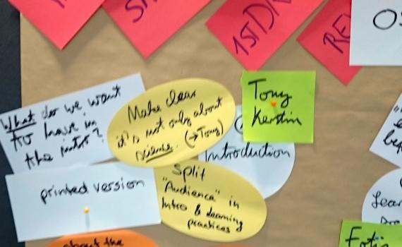 oard with post-it notes, with ideas written on them.
