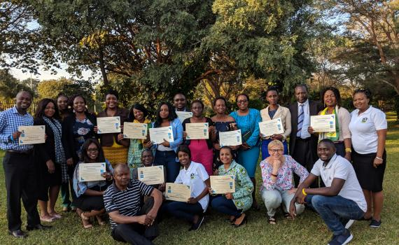 Group photo of Zambian public library trainers with certificates, after completing EIFL training of trainers programme.