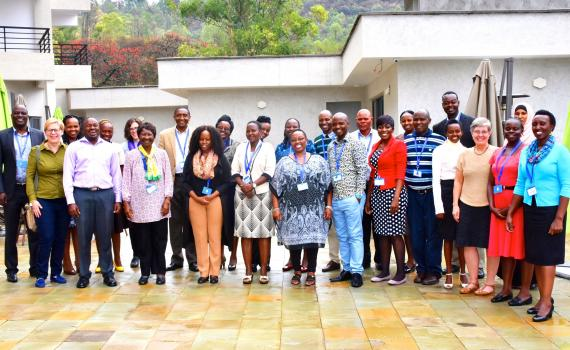 The 20 public librarians selected to be trainers with their trainers in a group photo.