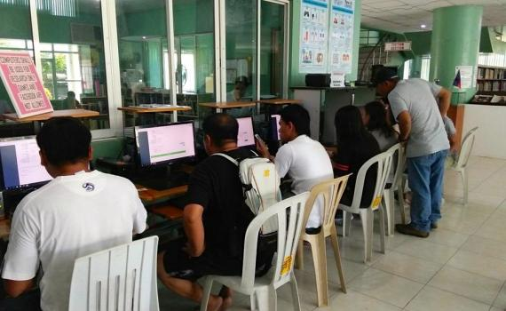 Overseas workers learn how to use computers and to apply online for their Overseas Employment Certificates in Butuan City Library.