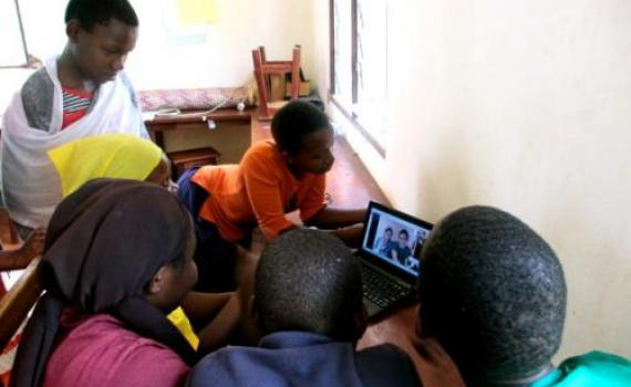 Deaf children chat to friends in Canada using Skype.