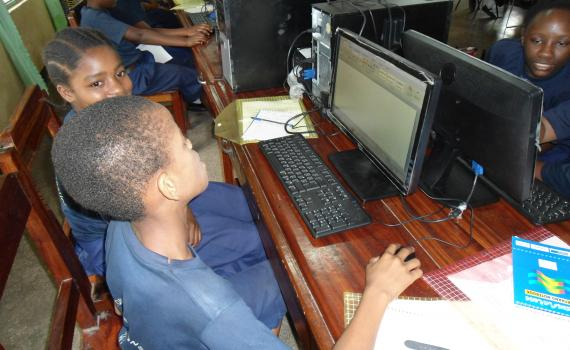 A young boy researches the internet in the Tanzania Central Library's computer room.