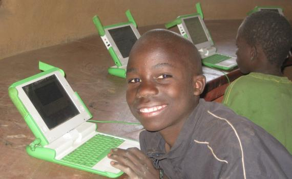 Children using laptop computers in the library.