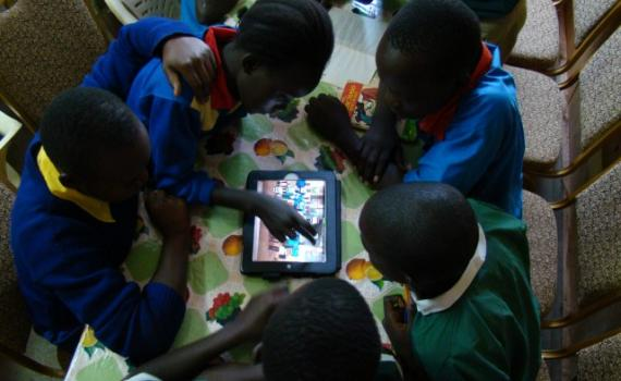 Children use tablet computers in the library.