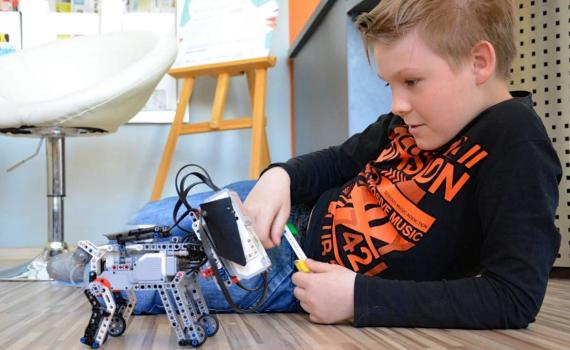 In the library's new 'ITLab', children learn to make robots and programme them to move.