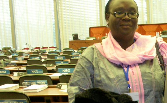 Awa Diouf Cissé in the picture standing in front of the conference room